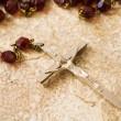 Rosary beads on stone — Stock Photo