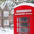 Telephone box with snow - Stock Photo