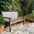 Garden bench in fall — Stock Photo