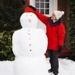 Person building snowman — Stock Photo