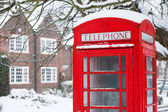 Telephone box with snow — Stock Photo