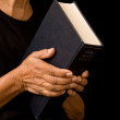 Old woman holding bible — Stock Photo #13277326