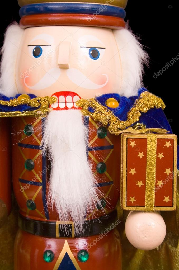 A traditional Christmas nutcracker ornament isolated on black — Stock Photo #13275313