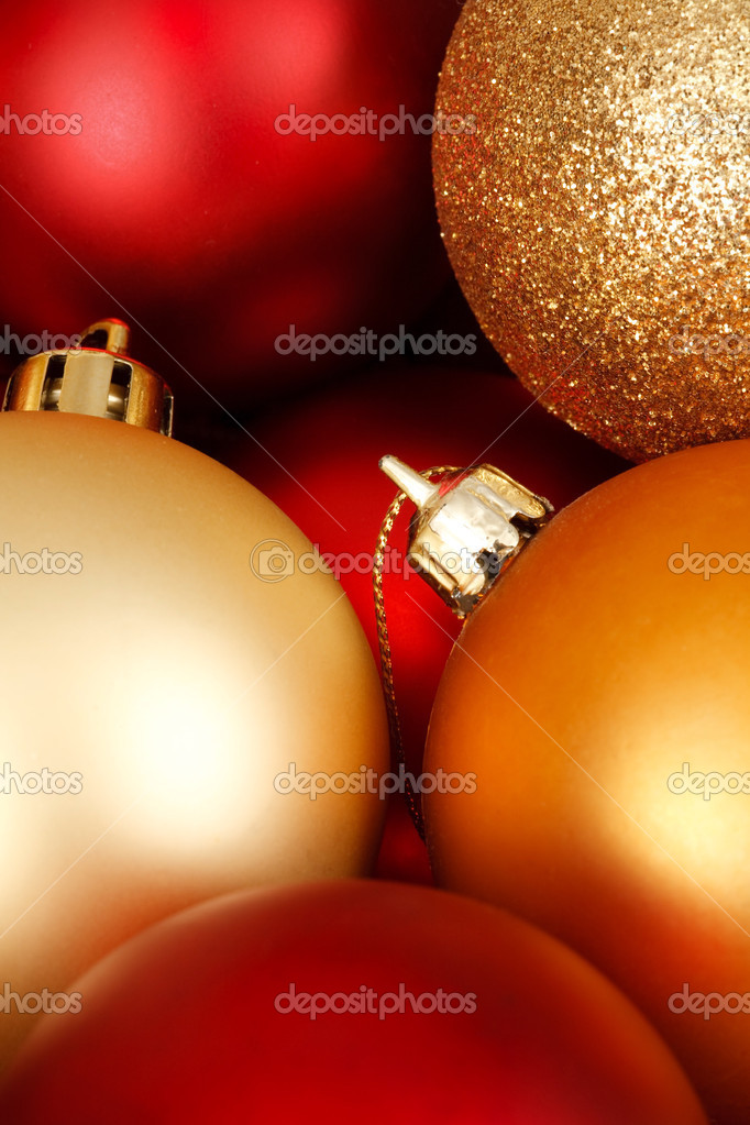 Closeup of glass christmas ornaments in red and gold — Stock Photo #13276127