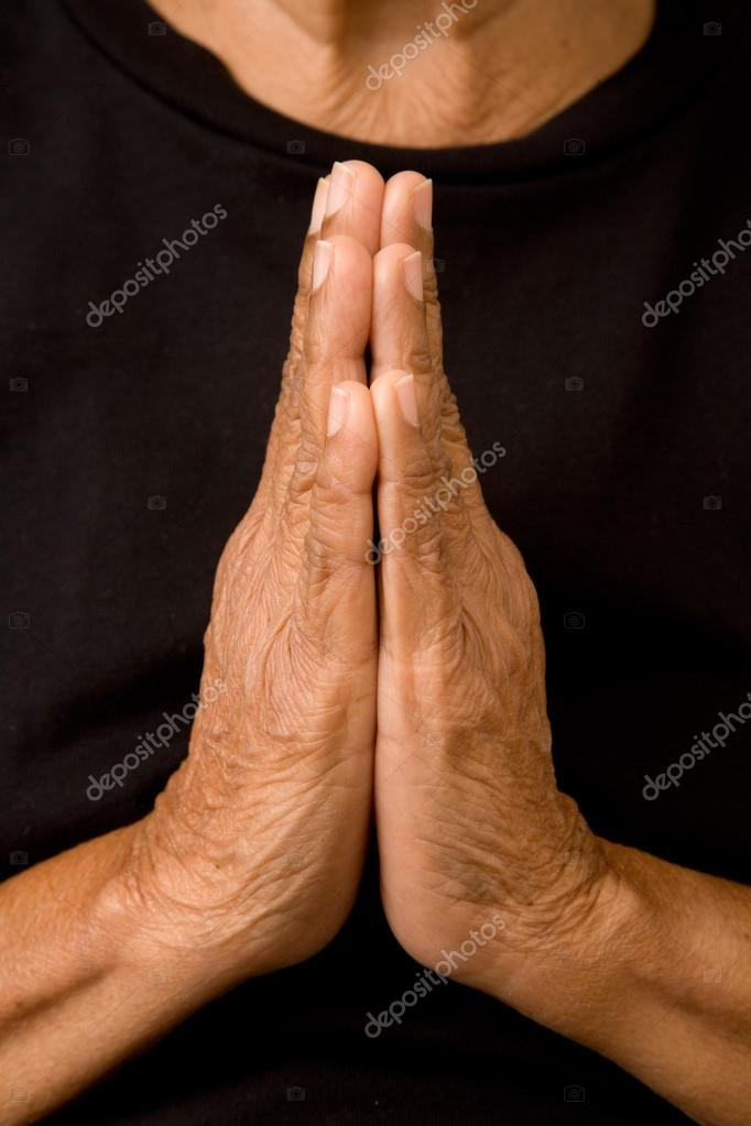 An old asian woman holds her hands in prayer — Stock Photo #13379362