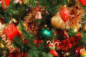 Christmas decorations on tree — Stock Photo