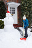 Person shovelling snow — Stock Photo