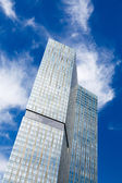 Skyscraper blue sky — Stock Photo