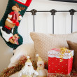Christmas stocking on bed — Stock Photo
