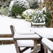 Garden furniture under snow — Stock Photo