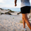 Runner on beach — Stock Photo