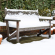 Garden bench in snow — Stock Photo