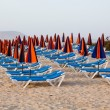 Sun loungers on beach — Stock Photo #49469605