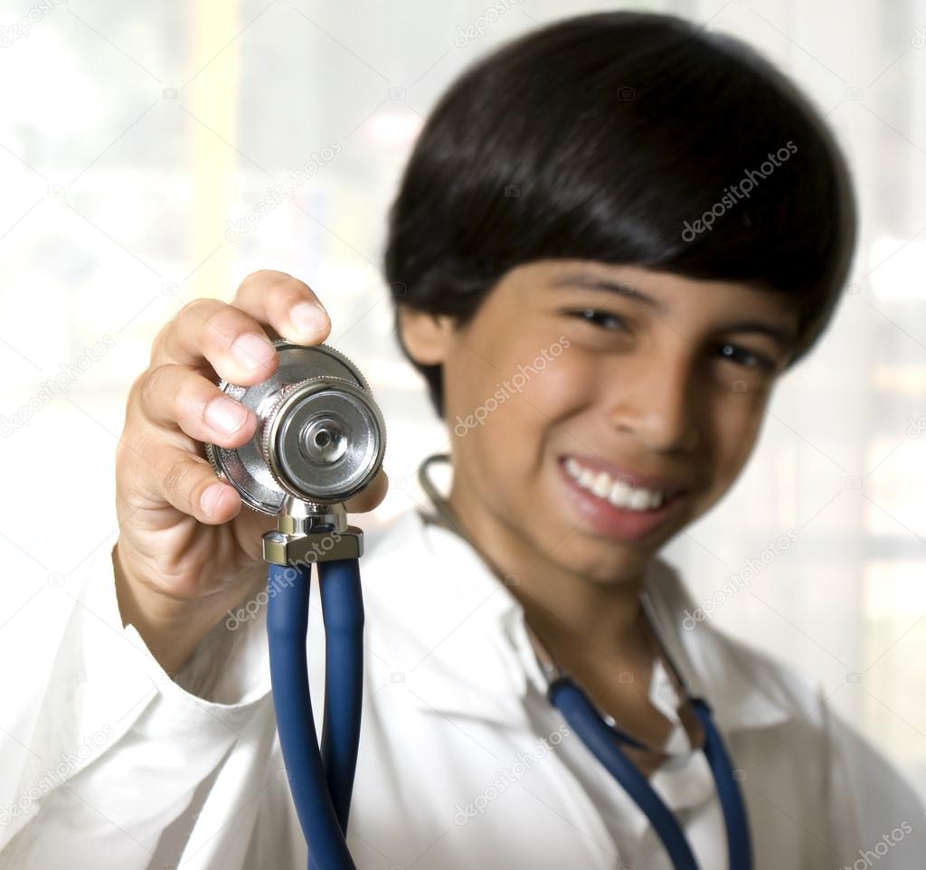 Boy holding a stetoscope — Stock Photo #12091518