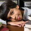Stock Photo: Frustrated and bored boy with books