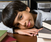 Frustrated and bored boy with books — Stock Photo