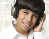 Boy listening music — Stock Photo