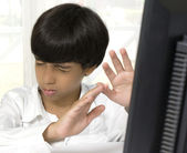 Surpised boy on computer — Stock Photo