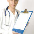 Young doctor holding a tablet — Stock Photo