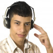 Young man listening to music — Stock Photo #13919744