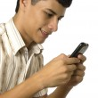 Young man chatting — Stock Photo