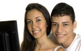 Smiling couple at the computer — Stock Photo