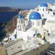 santorini greece oia village blue church dome architecture caldera view — Stock Photo