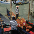 Venetian gondoliers work on gondolas — Stock Photo