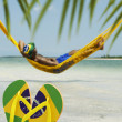 Man Relaxes in Hammock on Brazilian Beach — Stock Photo #35146869