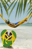 Man Relaxes in Hammock on Brazilian Beach — Stock Photo