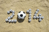 Brazil 2014 Soccer Football World Cup Message on Sand — Stockfoto