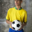 Young Brazilian Soccer Player in Uniform Holds Football — Stock Photo