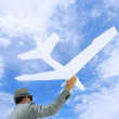 Entrepreneur Businessman Holds White Airplane In Sky — Stock Photo