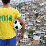 Brazil 2014 Football Player Standing with Soccer Ball Favela Rio — Stock Photo #38171371