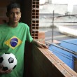 Stock Photo: Portrait of Young Brazilian Soccer Player Standing with Football
