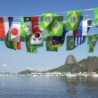 Stock Photo: BraziliInternational Flags Sugarloaf Mountain Rio de Janeiro Brazil