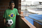 Portrait of Young Brazilian Soccer Player Standing with Football — Stock Photo