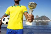 Champion Brazilian Soccer Player Holding Trophy and Football — Stock Photo
