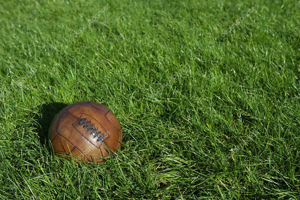 depositphotos_39228695-stock-photo-vintage-brown-football-soccer-ball.jpg