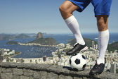 Brazilian Soccer Football Player Standing At Rio Skyline — Stockfoto