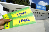 Soccer Fan Holding Two Brazil Tickets at the Stadium — Stockfoto