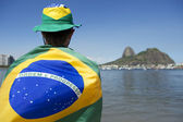 Patriotic Brazil Fan Standing Wrapped in Brazilian Flag Rio — Foto Stock
