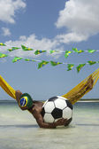 Brazilian Relaxing with Soccer Football in Beach Hammock — Stockfoto