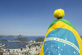 Patriotic Brazil Fan Standing Wrapped in Brazilian Flag Rio — Foto de Stock