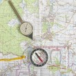 Tourist map with odometer and compass — Stock Photo
