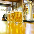 Three glasses of beer at the bar — Fotografia Stock  #20392637