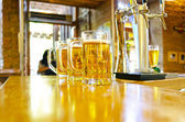 Three glasses of beer at the bar — Stock Photo