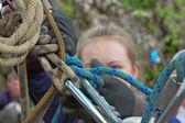 Female rock climber adjusting harness — Stock Photo