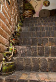 Brick stairs decorated old coal irons — Stock Photo