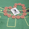 Poker chips and table — Stock Photo #14027794